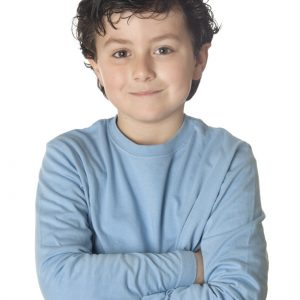 Funny child with blue shirt isolated on white background